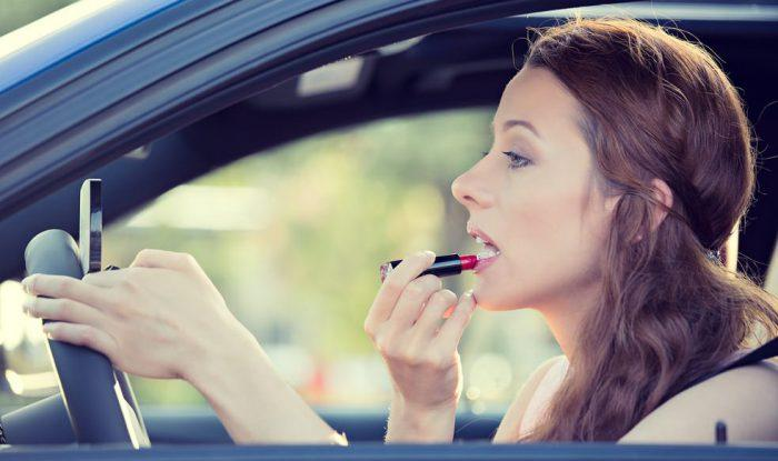 applying makeup in the car